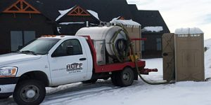 Huff Sanitation cleaning portable toilets in Riverton, Wyoming