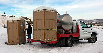 Huff Sanitation delivering portable toilets in Lander, Wyoming